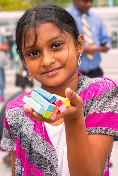 Indian Child with Colored Chalk